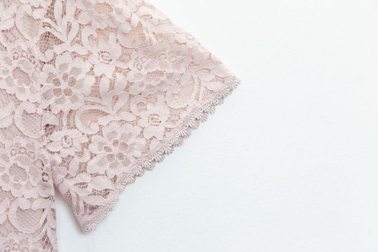 Pink lace with blouse.close up. Indoors  White Color White Background Textile No People Pattern Close-up Copy Space Art And Craft Lace - Textile Still Life Studio Shot Craft Design Pink Color Creativity Celebration Ribbon Floral Pattern Event Lace Blouse Beige Tailor