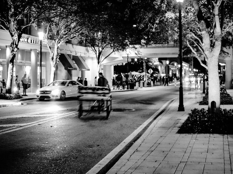 The Street Photographer - 2017 EyeEm Awards Blackandwhite Night Tree Transportation Car City Land Vehicle Street Building Exterior Outdoors Architecture Built Structure Road Bicycle Taxi