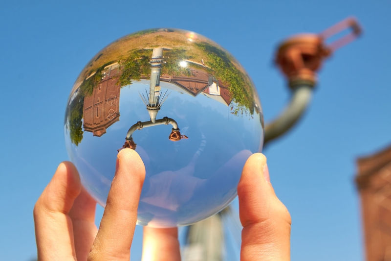 Protego cap Protego Protego Cap Sphere Blue Blue Background Clear Sky Close-up Day Finger Focus On Foreground Glass Glass Sphere Hand Holding Human Body Part Human Finger Human Hand Leisure Activity Lifestyles Nature One Person Outdoors Real People Sky Sunlight