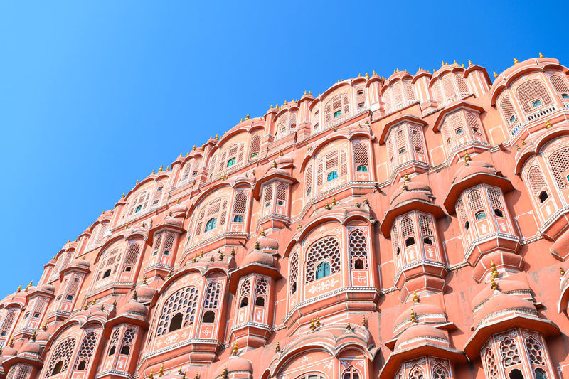Low angle view of historical building against clear blue sky