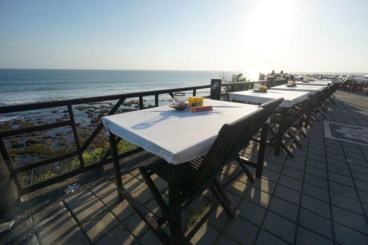 Empty Tables Overlooking Calm Sea