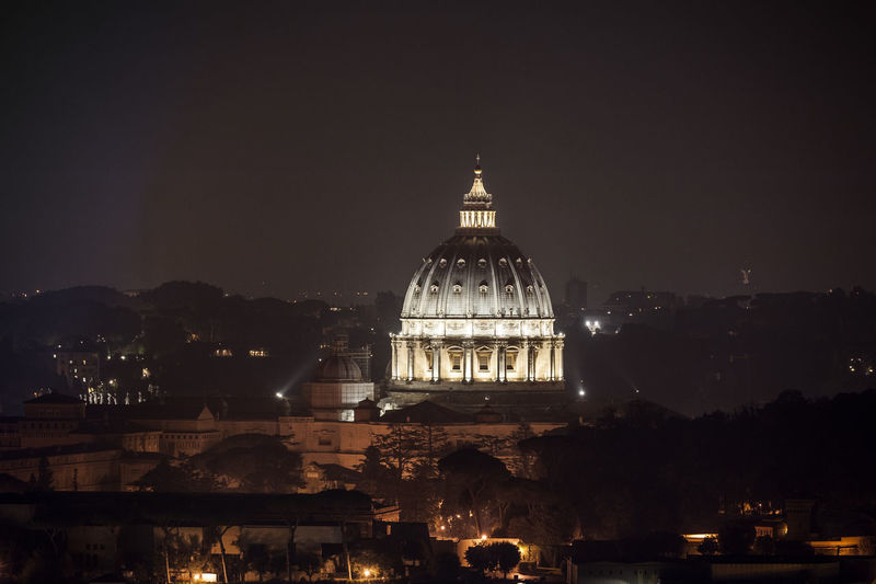 Illuminated san pietro in vatican city against sky at night