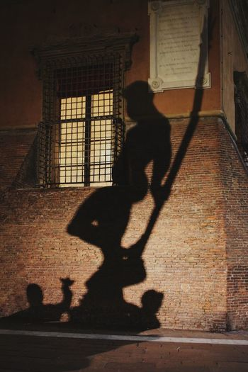 Neptune in Bologna Shadow Real People One Person Focus On Shadow Sunlight Lifestyles Full Length Men Leisure Activity Architecture Built Structure Walking Building Exterior Outdoors Silhouette Standing Day