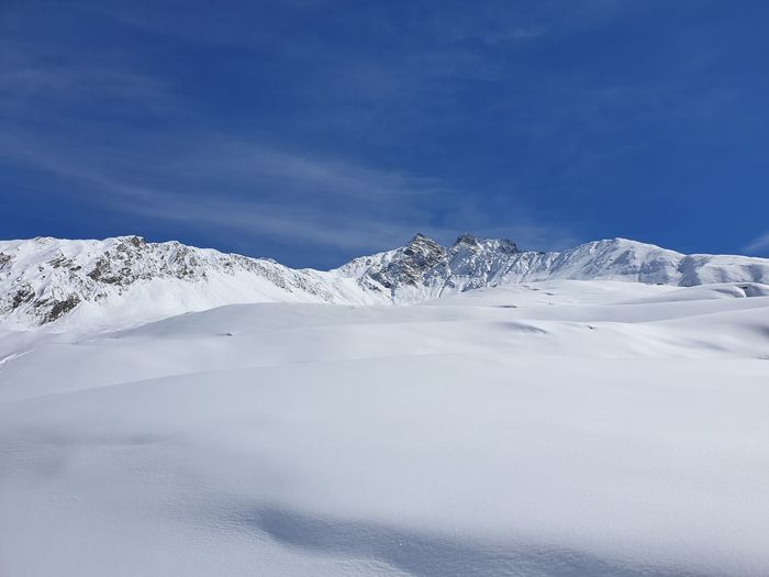 Winter Mountain Cold Temperature Snow Sky Beauty In Nature Scenics - Nature Tranquil Scene Tranquility Snowcapped Mountain White Color Blue Non-urban Scene Environment Cloud - Sky No People Day Mountain Range Nature Mountain Peak Powder Snow