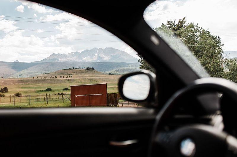 Cars on field seen through car window