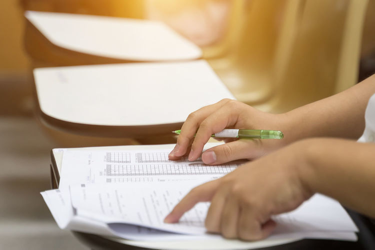 Adult Close-up College4 Document Education Exam Hand Holding Human Body Part Human Hand Indoors  Learning Note Pad One Person Paper Paperwork Pen Real People Selective Focus Studying Table Teenager University Women Writing