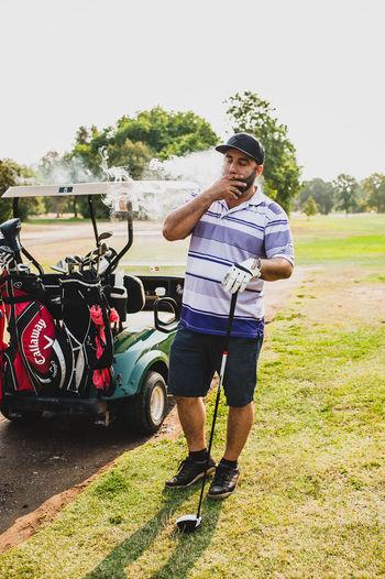 Ganja Golf League - Man Smoking #Ganja #weed Callaway Cannabis Golf Course Man Smoke Dank Full Frame Golfer Guy Puff