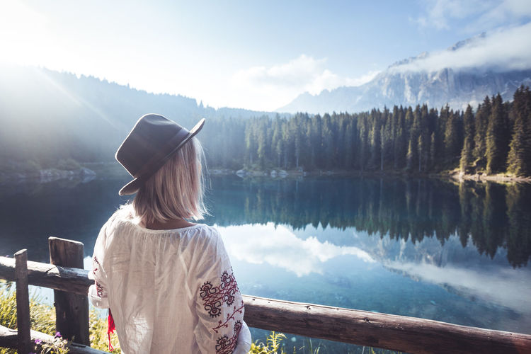 Rear View Beauty In Nature One Person Water Lake Real People Scenics - Nature Sky Leisure Activity Nature Adult Women Mountain Tranquility Tree Tranquil Scene Lifestyles Day Standing Hairstyle Looking At View Outdoors Hat Dolomites, Italy Karersee A New Perspective On Life