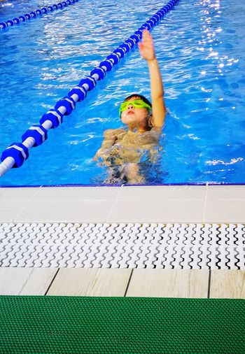 Child Boy Swimming Pool Water Swimming Swimming Lane Marker People Sport Competition Young Adult Day Competitive Sport