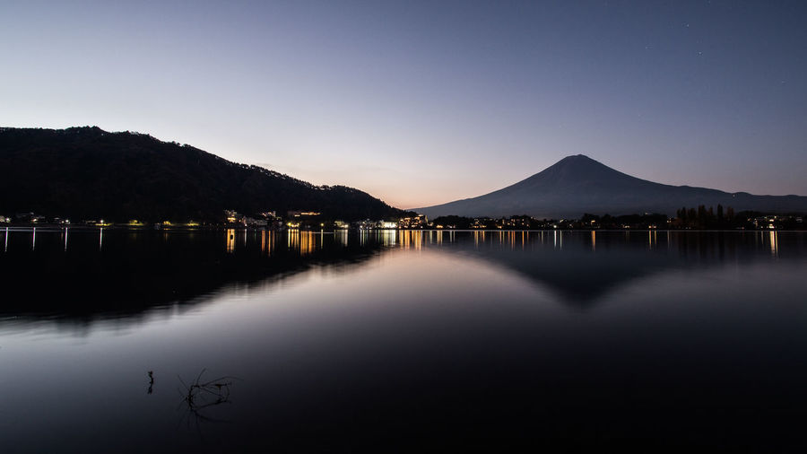 Mt' Fuji as seen from Kawaguchi Lake at 5am EyeEm Best Shots EyeEm Nature Lover Landscape_Collection Beauty In Nature Clear Sky Day Fuji Lake Landscape Mountain Nature No People Outdoors Reflection Scenics Silhouette Sky Sunset Tranquil Scene Tranquility Water Waterfront