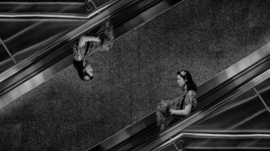 Multiple image of woman standing on escalator