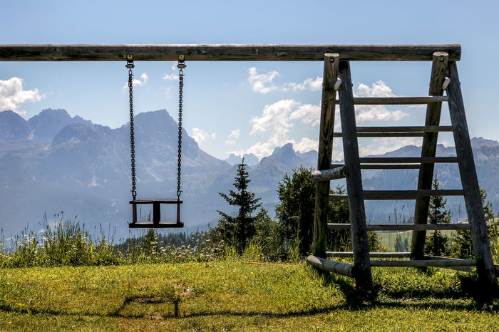 Altalena Beauty In Nature Bench Dolomites, Italy Grass Landscape Mountain Rural Scene Sky Tranquil Scene Tranquility Tree