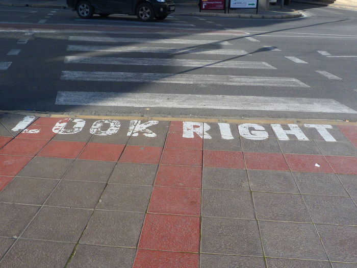 Look Right Malta Paceville Look Right Text Sign Communication Guidance Day Transportation Western Script Road Road Marking Marking No People Capital Letter Direction Street City Road Sign Footpath