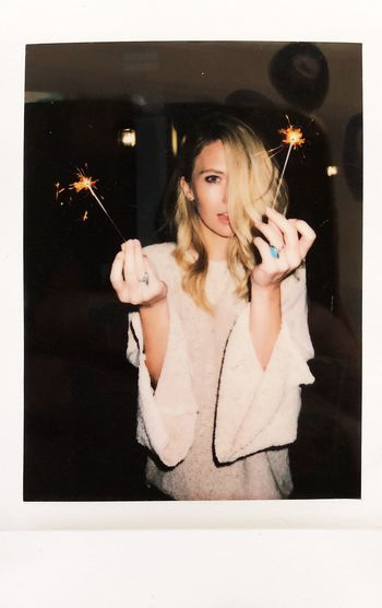 Instant photograph of an Attractive blond woman holding sparklers at night Firework Sparkler Celebrating Celebration Holiday Instant Polaroid One Person Women Young Adult Young Women Holding Hair Indoors  Beautiful Woman Adult Real People Portrait Front View Beauty Lifestyles Blond Hair