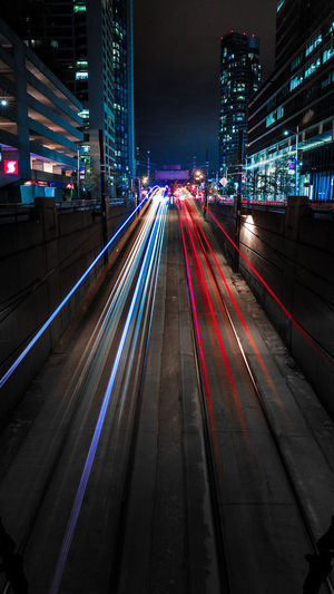 High angle view of light trails on street in city at night