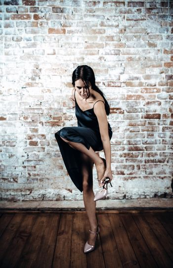 One Person Brick Wall Brick Full Length Adult Dancing Young Adult Ballet Women Indoors  Wall Wall - Building Feature Ballet Dancer Beauty Elégance Beautiful Woman Lifestyles Portrait Hairstyle Contemplation