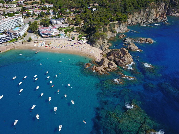 Aerial Shot Blue Sea Catalunya Rocky Coastline Aerial View Architecture Beach Beauty In Nature Building Exterior Clear Water Day High Angle View Nature Nautical Vessel No People Outdoors Scenics Sea Water Yacht
