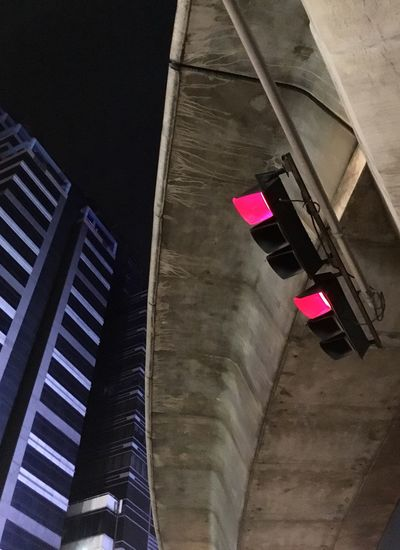 Low angle view of illuminated buildings in city