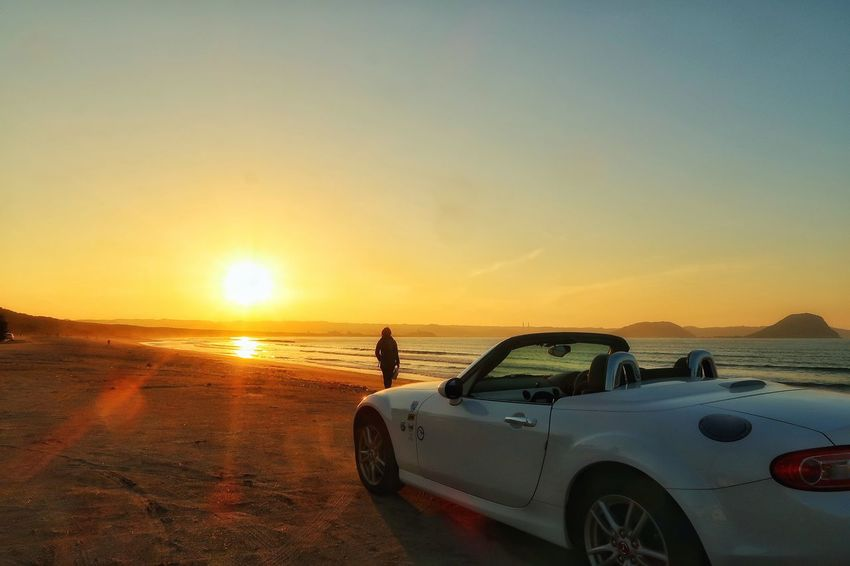 夕焼け空 One Person Drivebyphotography Drive EyeEm Japan Photography 夕焼け 空 風景 海 夕陽 マツダ ロードスター ドライブ Sunset_collection Mazda Mx5 Miata Car EyeEm Nature Lover Men Beach Sea Eyesight Adventure Standing Car Road Trip Sun Force Sports Utility Vehicle