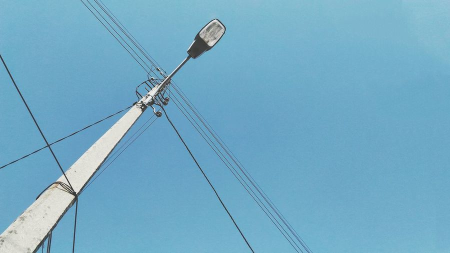 Blue Low Angle View Cable Connection Technology Electricity  No People Outdoors Sky Day Clear Sky Street Light Power Line  Blue Sky Negative Space