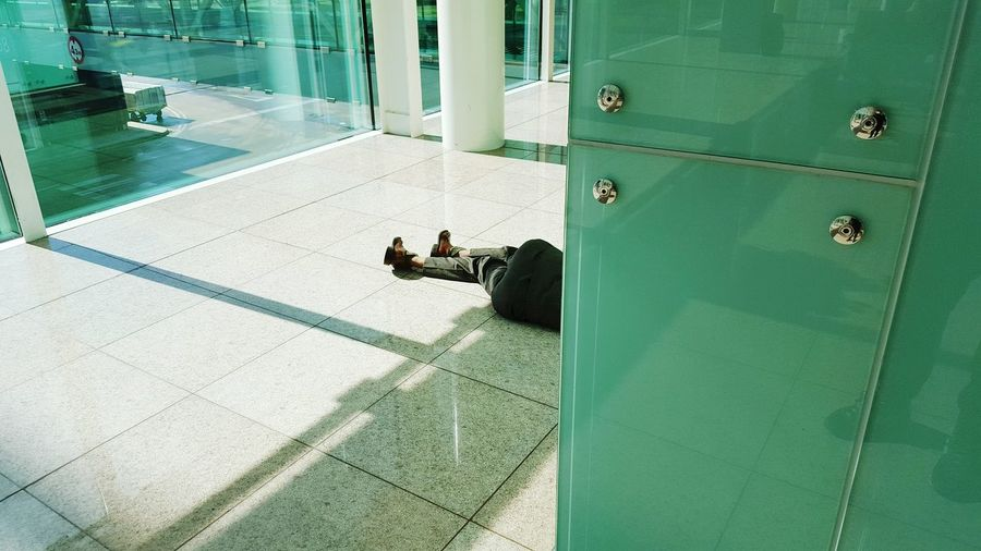 Low section of people lying on floor