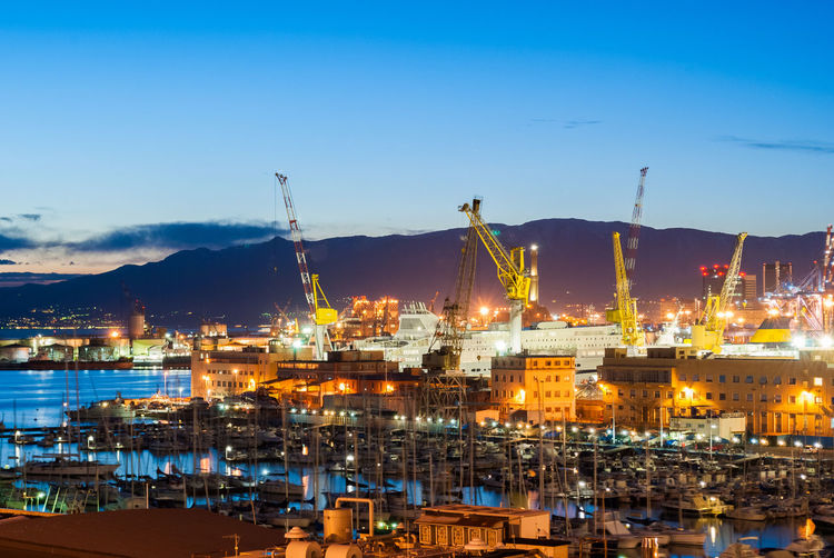 Harbor of Genova seen after the sunset Blue Hour Boats City Cityscapes Cranes Harbor Illuminated Industry Italy Lights Liguria Long Exposure Night Outdoors Port Sky Skyline Sunset Twilight Urban