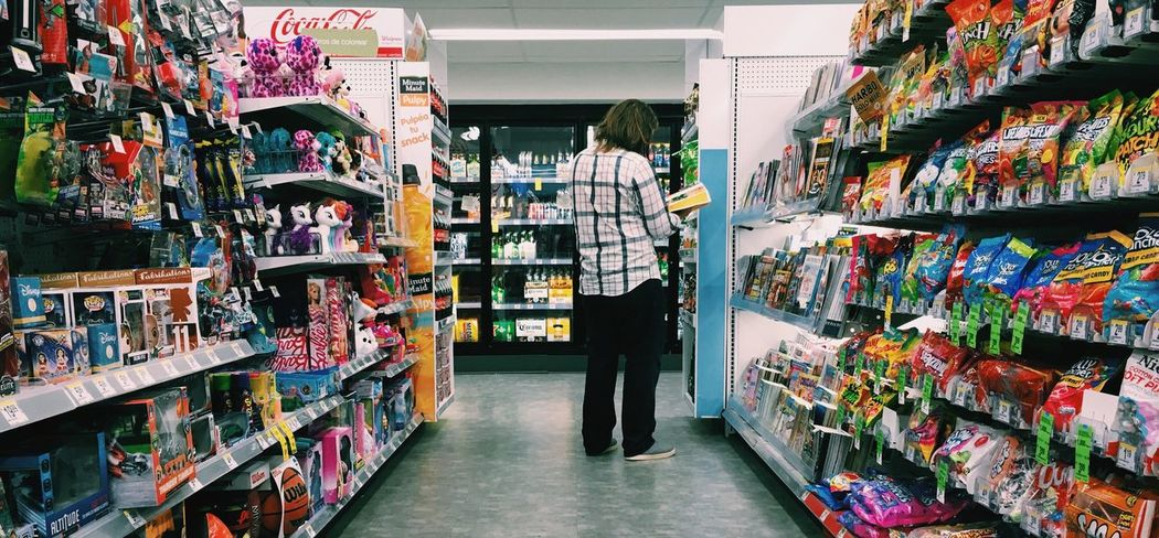 Distracted Distracted Mood Captures Store Farmacy Magazine Busy Place Cinematic Narrative Cinematography Cinematic Photography Wide Shot Candy Candyshop First Eyeem Photo