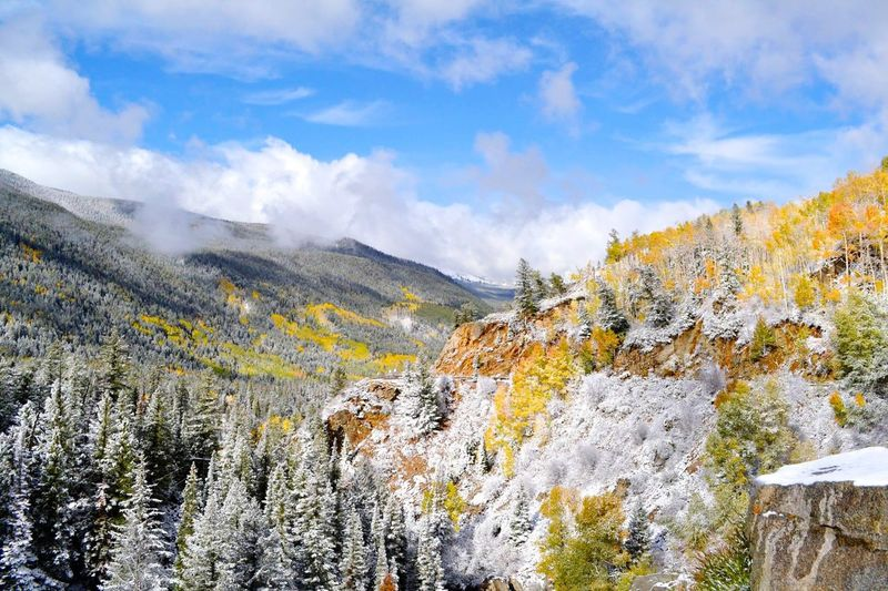 Travel Destinations Fall Colors Seasons Collide Autumn Cloud - Sky Beauty In Nature Sky Mountain Scenics - Nature Tranquility Tranquil Scene Nature Day No People Snow Mountain Range Winter Outdoors Environment Non-urban Scene Landscape Tree
