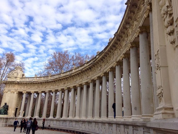 Architecture Built Structure Travel Destinations Real People Architectural Column Tourism Building Exterior History Low Angle View Sky Tourist Day Outdoors Men Sculpture Madrid Spain Madrid El Retiro ElRetiro Parqueelretiro