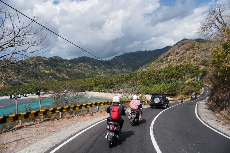 Indonesia, Lombok Island West Nusa Tenggara (NTB), on Sunday (5/8/2018) at around 6:46 p.m., the earthquake with a strength reached 7.0 on the Richter Scale (SR). The photo was taken 3 days after the earthquake along the road to North Lombok which suffered the worst damage. residents make emergency tents along the main road and wait for government assistance and donations from volunteers. the situation in Lombok is still severe, making traffic jams everywhere, scrambling for help to survive. Transportation Mountain Mode Of Transportation Road Land Vehicle Sky Nature Mountain Range Cloud - Sky Plant Day Water Beauty In Nature Motorcycle Sign Travel Tree Real People Scenics - Nature Outdoors Riding Earthquake Earthquake Area Lombok Lombok-Indonesia Humanity Meets Technology