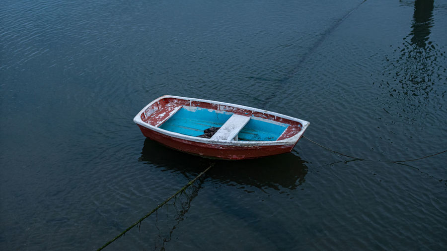High angle view of abandoned boat moored on lake