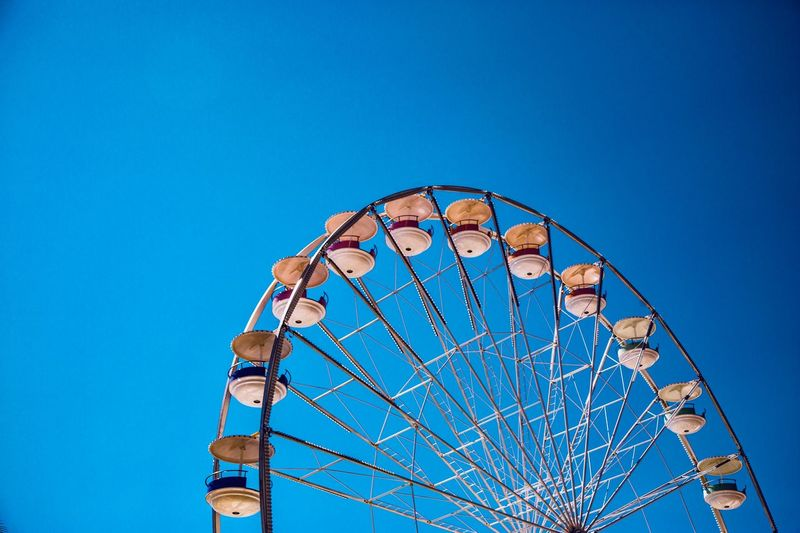Around Ride Blue Simple EyeEm Selects Amusement Park Ride Blue Ferris Wheel Amusement Park Sky Low Angle View No People Day Clear Sky Circle Geometric Shape Arts Culture And Entertainment