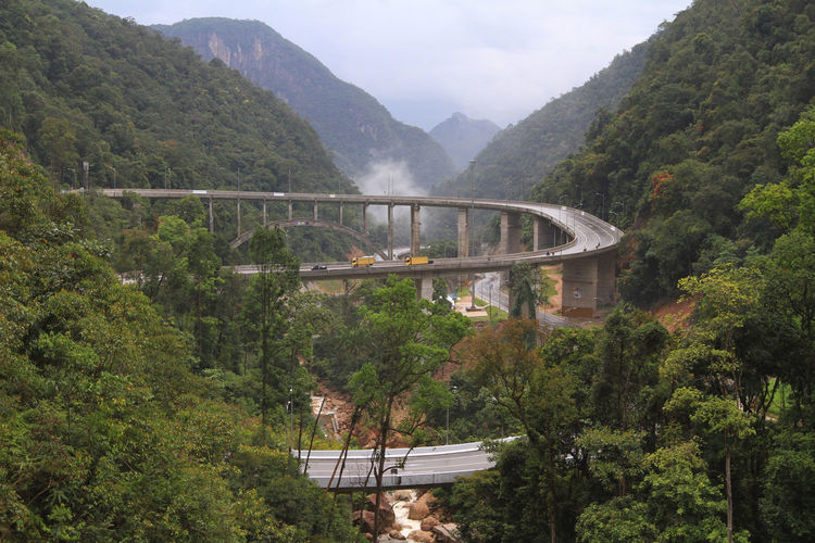Curved Nine is winding road which is located about 30 km east of Payakumbuh, West Sumatra, heading Riau Province. Architecture Beauty In Nature Bridge - Man Made Structure Day Infrastructure Mountain Nature No People Outdoors Road Scenics Tree