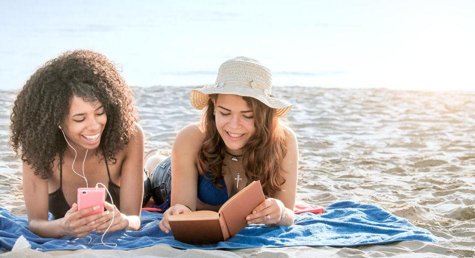 Smiling Female Friends At Beach