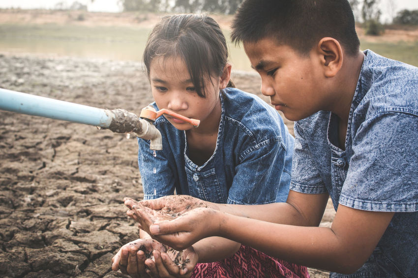 Asian  Drought Earth Hope Hot Land Life Nature Boy Broken Change Climate Concept Crack Environment Girl Ground Heat Human Kid Outdoor Sad Shortage Soil Water
