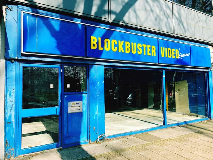 Blockbuster is dead, long live Netflix High Street Disruption Blockbuster Text Communication Western Script Sign No People Entrance Day Building Exterior Blue First Eyeem Photo