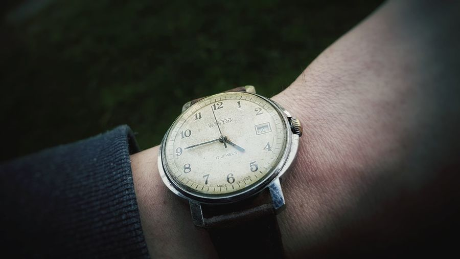 A vintage Wostock watch from '50s Wostock Russian Russian Watch Vintage Vintage Watch Minute Hand Human Finger Wrist Hour Hand