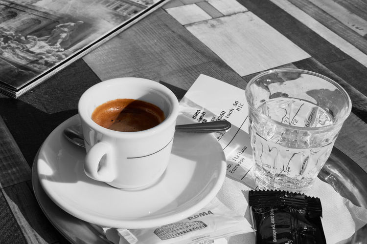 NEUSS, GERMANY - APRIL 04, 2016: Espresso is served in one of the Italian bars. Breakfast Close-up Coffee - Drink Coffee Cup Coffee Pot Cup Day Drink Food And Drink Freshness High Angle View Indoors  Neuss No People Plate Refreshment Saucer Spoon Sugar Cube Table Tea Cup