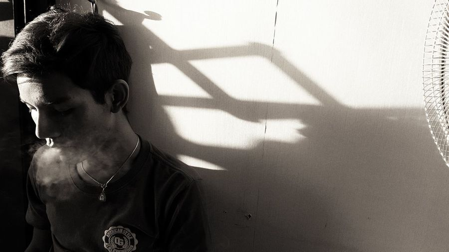 Portrait of man with shadow on floor