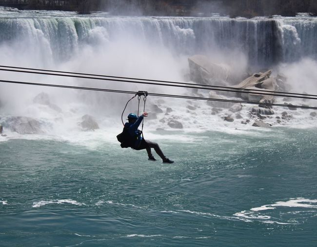 Zipline Niagara Water Extreme Sports Full Length Men Adventure RISK Sky Waterfall Safety Harness Flowing Water