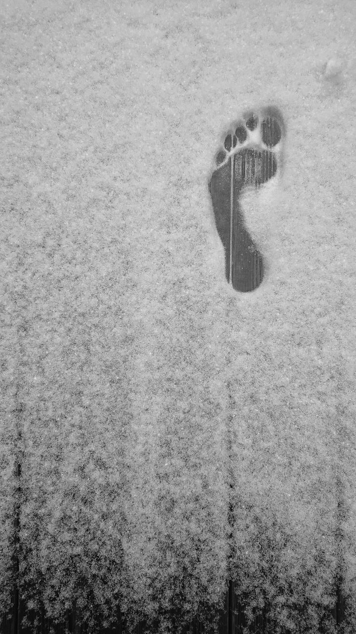no people, day, snow, cold temperature, nature, winter, high angle view, wall - building feature, outdoors, land, built structure, close-up, communication, single object, architecture, retro styled, technology, water, concrete