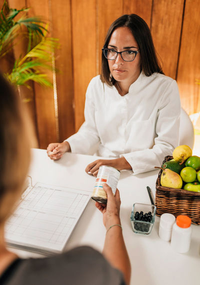 Nutritionist talking with patient at weight loss clinic