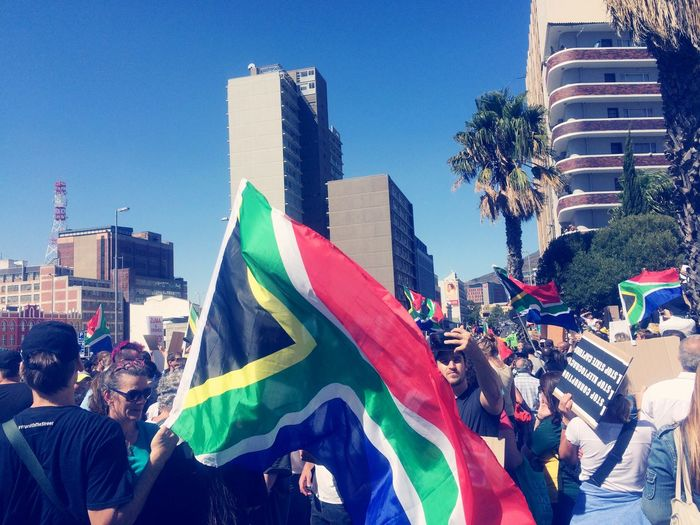 Protests marches in Cape Town South Africa to fire our ex State President March Together Mass Protest Unification United People Protests Protesters Crowds Of People Building Exterior Architecture City Crowd Flag Built Structure The Photojournalist - 2018 EyeEm Awards Group Of People Sky Large Group Of People Real People Day Clear Sky Multi Colored Patriotism City Life Women Outdoors Office Building Exterior