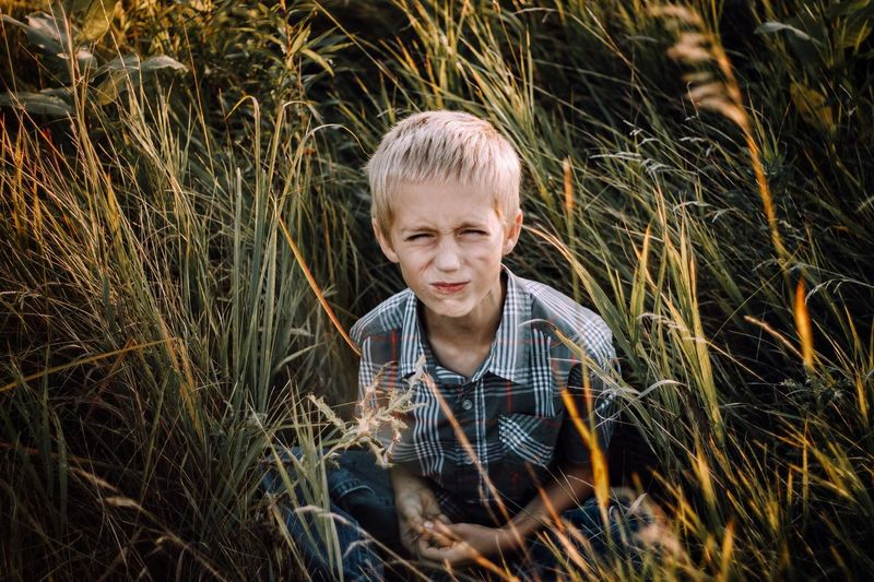 Attitude. Blond Hair Children Only Childhood One Person Outdoors Child Grass One Boy Only People Headshot Boys Front View Day Nature Males  Smiling Vacations Happiness Rural Scene Portrait