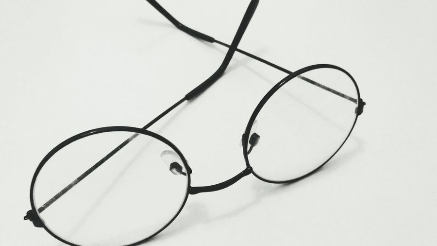 High angle view of eyeglasses against white background
