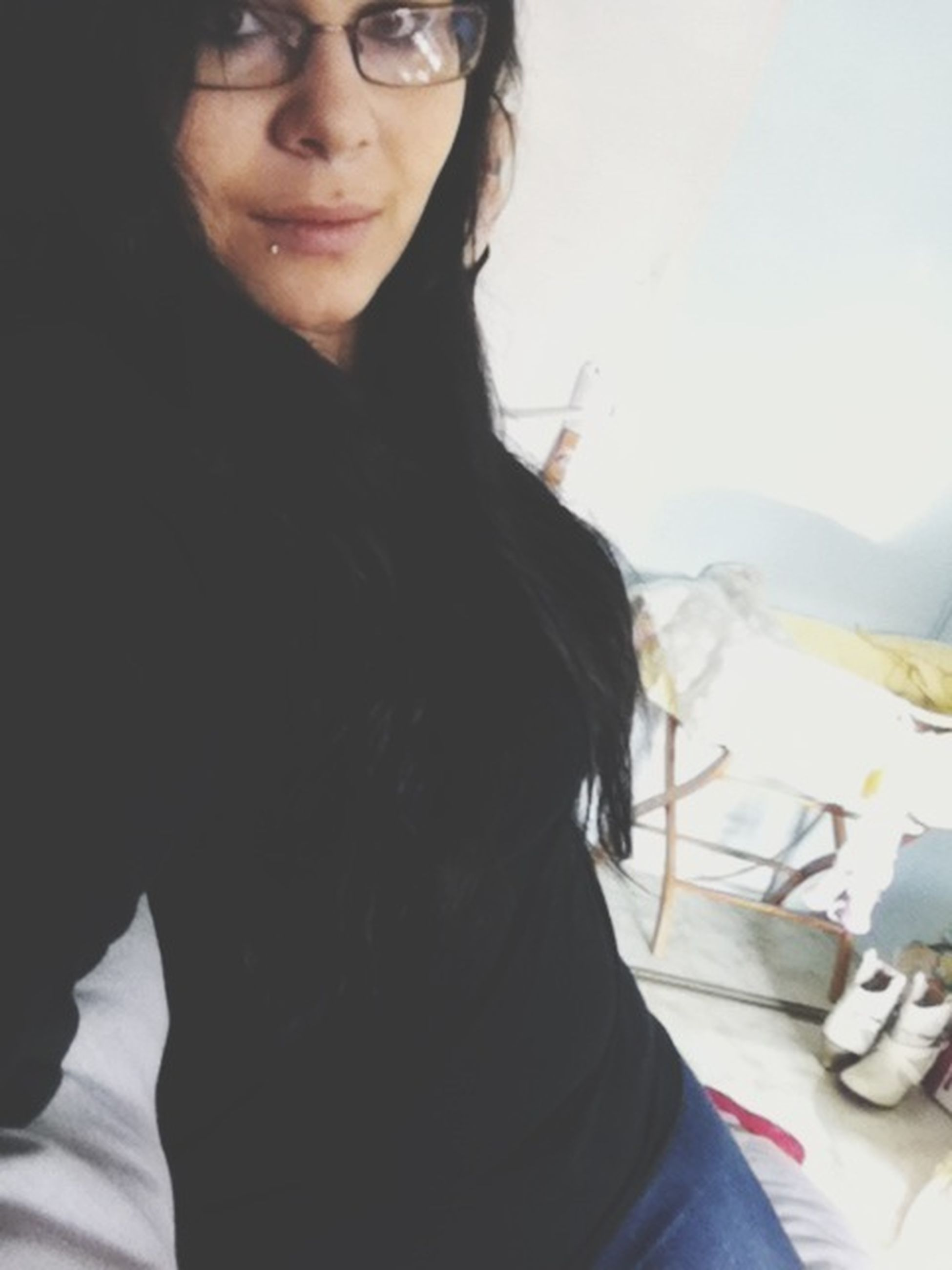 young adult, young women, lifestyles, person, headshot, leisure activity, long hair, portrait, front view, looking at camera, casual clothing, close-up, head and shoulders, black hair, focus on foreground, indoors