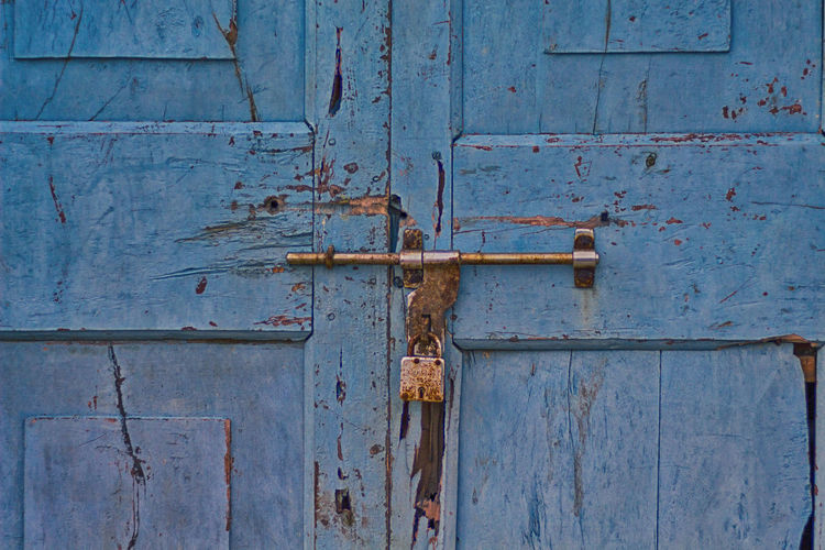 Locked Door. Backgrounds Blue Close-up Closed Day Deterioration Door Entrance Full Frame Latch Lock Metal No People Old Outdoors Protection Ruined Rusty Safety Security Textured  Weathered Wood - Material