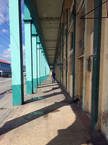 Perspective Shadows & Lights Street View Traveling Architectural Column Architecture Building Exterior Built Structure Columns Outdoors Santiago De Cuba Shadow Street Photography Sunlight The Way Forward
