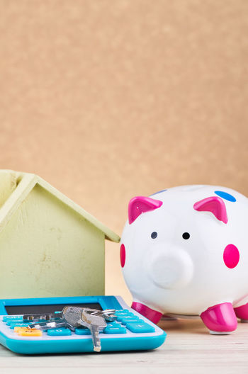 bunch of key, calculator and white piggy bank over reverberation gradient background Still Life Table Indoors  No People Close-up Animal Representation Representation Piggy Bank Toy Pink Color Savings Wood - Material Focus On Foreground Investment Animal Themes Animal Finance Copy Space Mammal