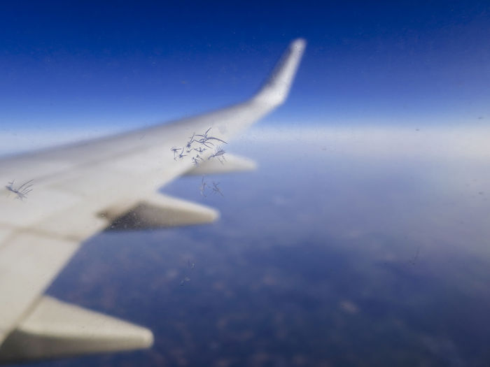 In to the sky, view from a scrached window of the airplaine Aiplane Airplane Airplane Wing AirPlane ✈ Airplaneview Animal Themes Close-up Day In To The Sky Into The Sky Material Nature No People Object Sky Sky And Clouds Window Windows